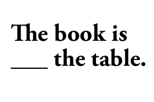 The book is _the table.